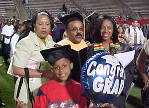 Dr. Robert Mikell Poses with African American Studies Outstanding Student of the Year Shauntel Kelso and Family (26kb)