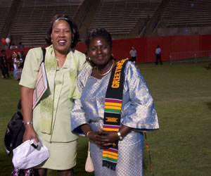 Outstanding Graduate Shauntel Kelso's Proud Mom Heddie (left) Shares the Moment with Mrs. Vivian Oheneba-Sakyi (21kb)
