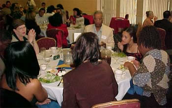 Program Administrative Assistant, Vonda Epperson and Professor Arthur Wint at Luncheon (21kb)
