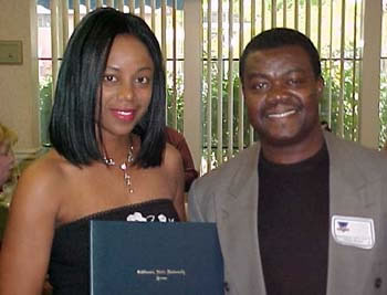 Shauntel Receiving Outstanding Graduating Student Award from Dr. Yaw Oheneba-Sakyi (20kb)