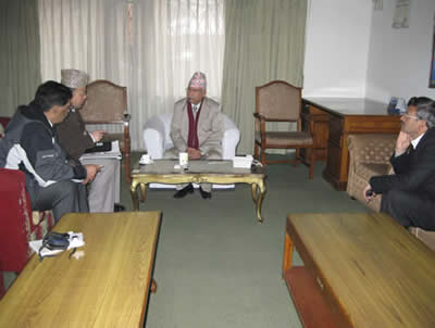 Dr. Dangi with Prime Minister of Nepal