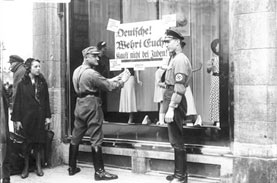 nazis standing before a sign
